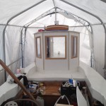 Rutorna är på plats och någon har målat hytten vit...